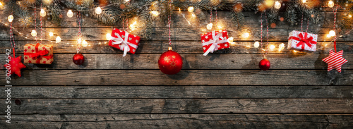 Fotomural  Christmas background with wooden decorations and spot lights.