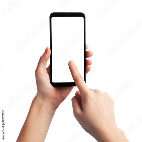 Foto  Woman holding and touching smartphone with empty screen isolated on white background, front view