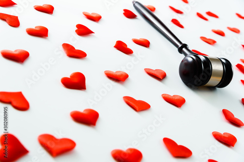 Gavel surrounded by red hearts, isolated on white, concept of legal action for divorce Wallpaper Mural