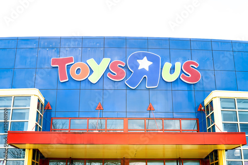 Fairfax, USA - April 5, 2018: Closeup of Toys R US store shop sign, logo in Virginia, entrance, facade, storefront, colorful architecture with nobody
