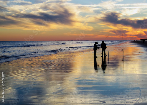 Beach Fishing at Dusk Wallpaper Mural