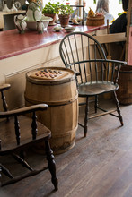 Chairs Barrel And Checkers Board In Old Store