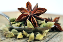 Traditional Spices. Cardamom And Anise Stars In A Spoon On A Wooden Table. Close Up.