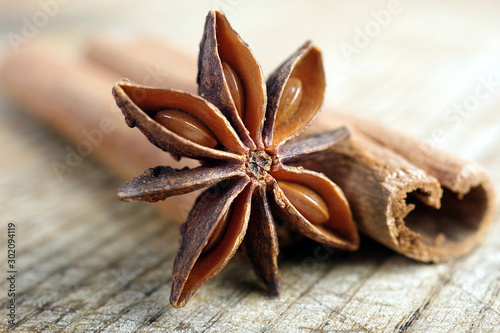 Obraz anise star and cinnamon on a wooden table close up. - fototapety do salonu