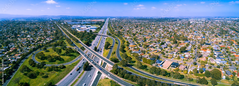 Fototapeta Scenic aerial panorama of highway interchange in greater Melbourne suburbs on sunny day