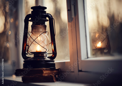 Obraz Vintage kerosene lamp and old books - fototapety do salonu
