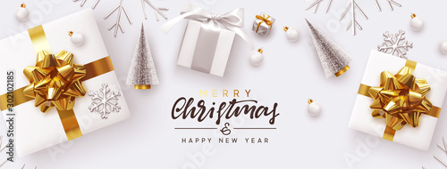 Fototapeta Holiday banner Merry Christmas and Happy New Year. Xmas design white gifts boxes, silver volume snowflake, glass ball. Christmas tree. flat lay, top view. Horizontal festive poster, header for website obraz na płótnie