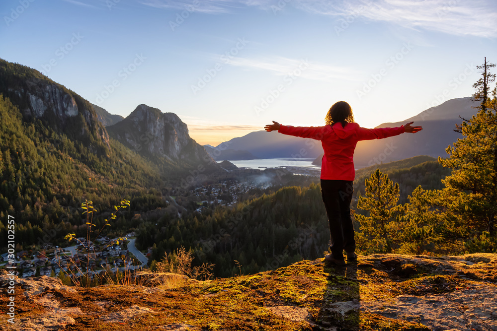 Fototapety, obrazy: Adventurous Girl Hiking in the mountains during a sunny Autumn Sunset. Taken Squamish, North of Vancouver, British Columbia, Canada. Concept: Adventure, freedom, lifestyle
