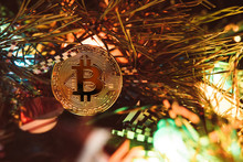 Gold Bitcoin. Crypto Currency Bitcoin On A Christmas Background