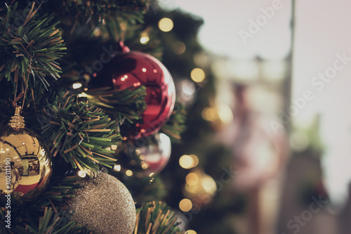 Photo  bauble hanging from a decorated Christmas tree