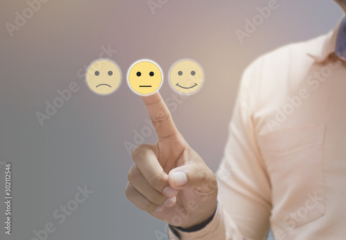 Fotomural Businessman pressing sad face touch screen , Business Service Satisfaction conce