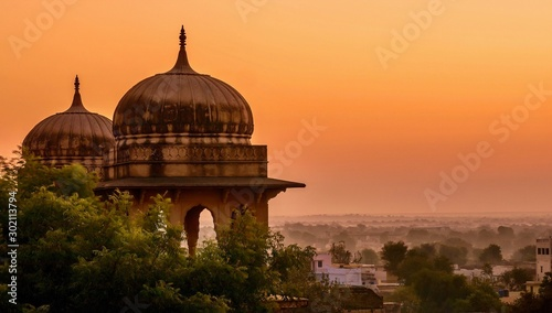 Traditional north Indian palace domes in low light, almost silhouetted against the beautiful dawn sky, in Mandawa, Rajasthan, India Canvas Print