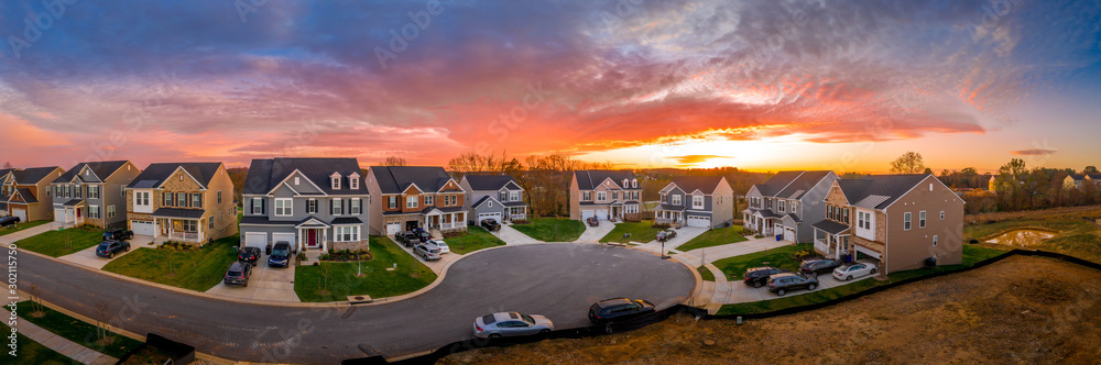 Fototapety, obrazy: Aerial view of new construction cul-de-sac street with luxury houses in a Maryland upper middle class neighborhood American real estate development in the USA with stunning sunset orange color sky