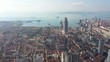 High angle drone flight of historic European (German) low-rise buildings towards city center and beautiful coastline of Qingdao, China