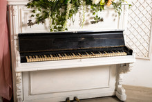 An Old Piano In A Bright Room