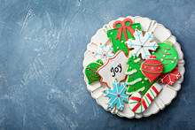 Christmas Sugar And Gingerbread Cookies Decorated With Royal Icing On A Plate Overhead