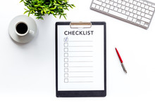 Checklist On White Office Background Top View