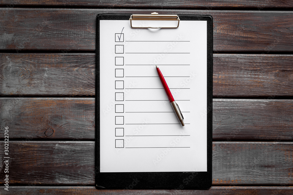 Fototapeta Empty check list ready to fill on dark wooden background top view