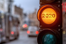 A City Crossing With A Semaphore. Orange Light With Text 2020 In Semaphore. Symbolic New Year Approaching Concept