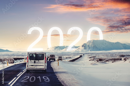 Poster Fleur New year and new achievements concept. Group of car driving on the road heading to 2020 with 2019 on the road