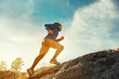 Leinwanddruck Bild - Skyrunner skyrunning crosscountry concept with young athlete on big rock