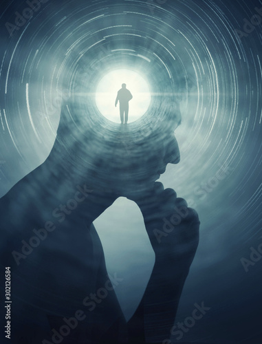 A silhouete of a man with rays of light emanating from the brain as a symbol of the power of thinking Fototapeta