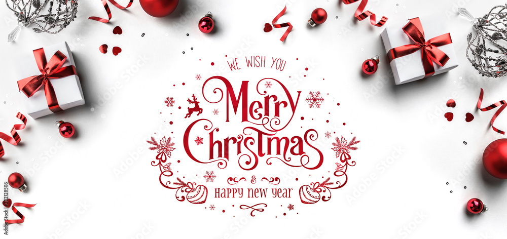 Fototapety, obrazy: Merry Christmas and New Year text on white background with gift boxes, ribbons, red decoration, bokeh, sparkles and confetti. Xmas greeting card, bokeh, light. Flat lay, top view