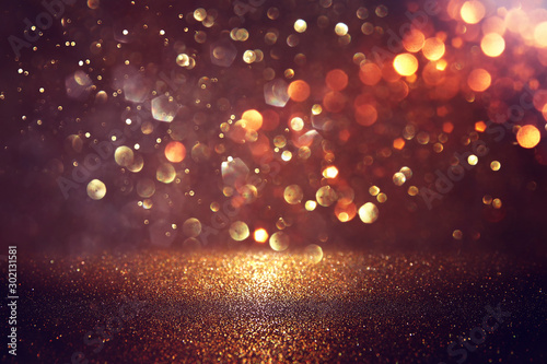 Fototapeta background of abstract glitter lights. gold and black. de focused obraz na płótnie