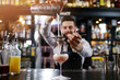 canvas print picture - Professional bartender is making cocktail at night club