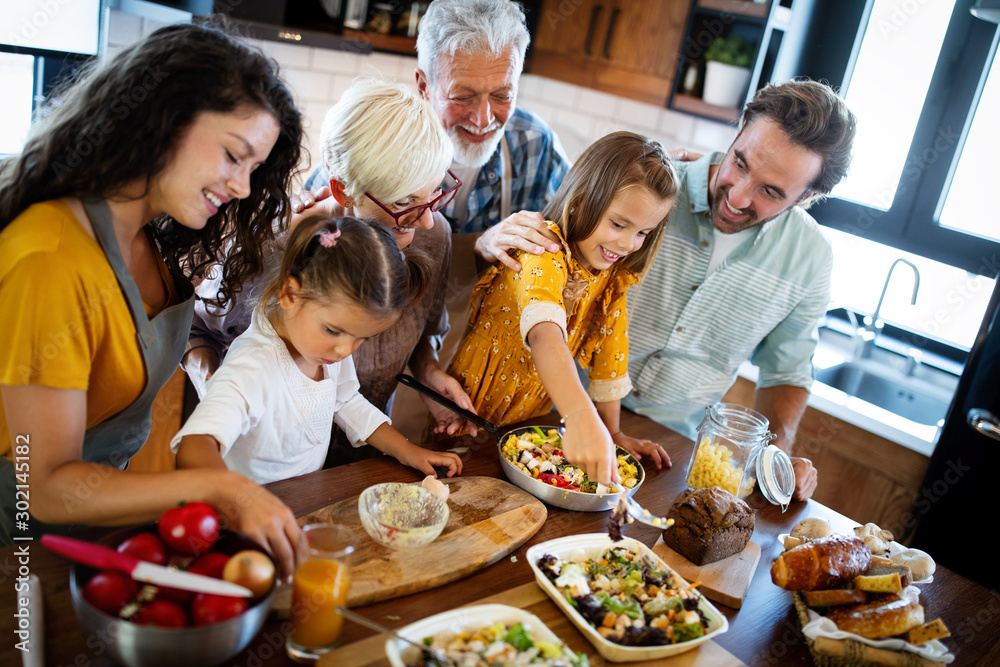 Fototapety, obrazy: Portrait of happy family in kitchen at home