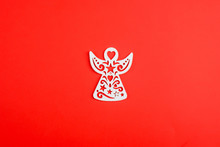 White Christmas Angel Ornament On Red Background, New Year Toys. Xmas.