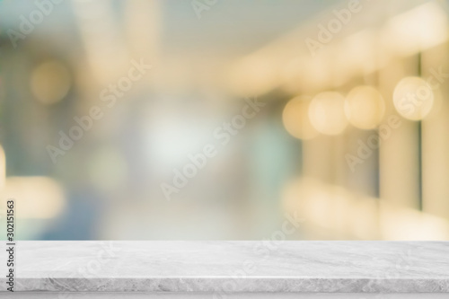 Obraz Empty white marble stone table top and blur glass window interior restaurant banner mock up abstract background - can used for display or montage your products. - fototapety do salonu