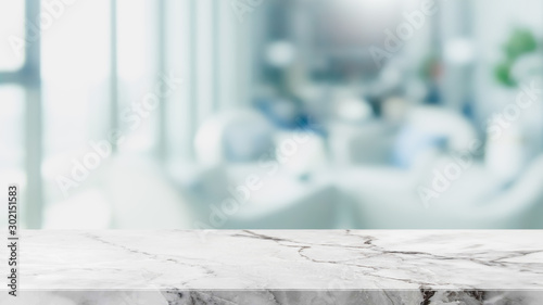 Fotografie, Obraz  Empty white marble stone table top and blur glass window interior restaurant banner mock up abstract background - can used for display or montage your products