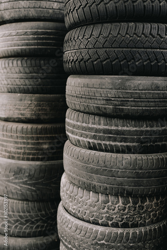 Car tires stacked next to each other. Wall mural
