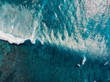 Aerial view with surfers and wave in crystal ocean. Top view