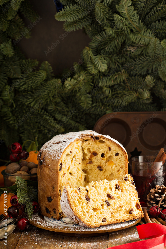 Fototapety, obrazy: Traditional Christmas panettone with dried fruits and orange zest on rustic background