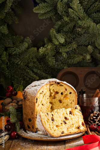 obraz PCV Traditional Christmas panettone with dried fruits and orange zest on rustic background