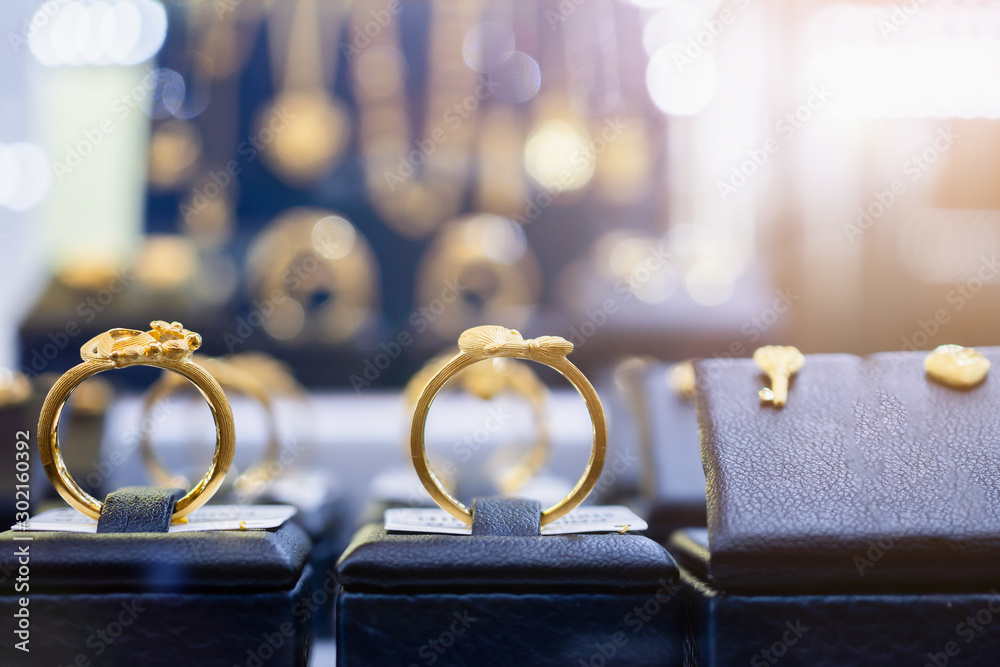 Fototapety, obrazy: Jewelry golden rings earrings and necklaces show in luxury retail store window display showcase