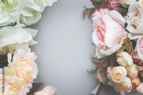 Foto auf Leinwand Blumen Bouquet of artificial pastel color flowers on gray background, top view with copy space