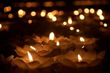 Candle Of Loy Krathong Festival. Beautiful Lotus Flower Shaped Candles Shining At Night
