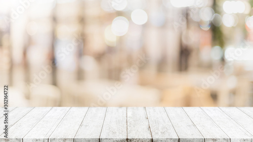Fotografie, Obraz  Empty wood table top and blur glass window wall building banner mock up abstract background - can used for display or montage your products