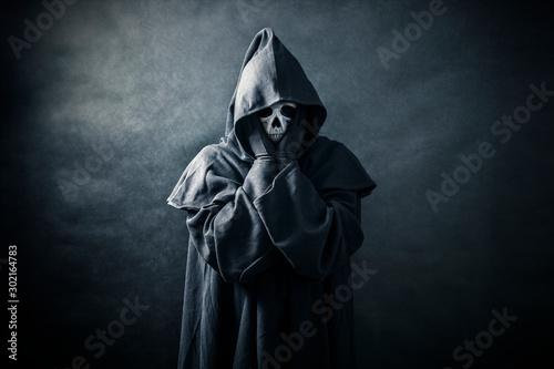 Ghostly figure in hooded cloak Wallpaper Mural