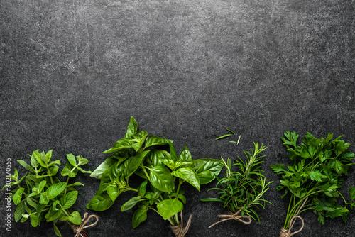 Fototapeta Bunch of fresh herbs from the garden. Mint, basil, parsley and rosemary herb on dark background. obraz