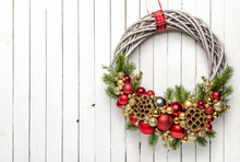 Golden And Red Composition Of Baubles On Christmas Wreath On Wooden Background