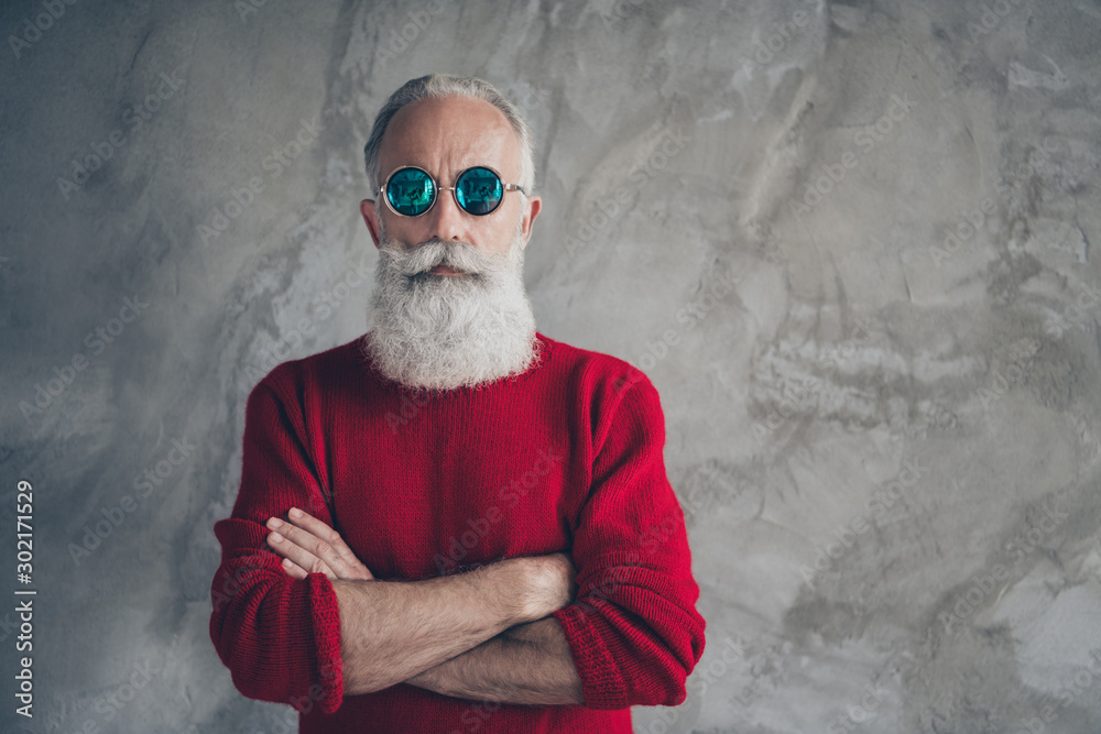 Fototapeta Portrait of serious harsh masculine old man cross hands look stunning prepare s-mas party time celebration wear stylish pullover isolated over grey concrete wall color background
