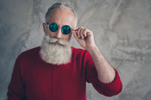 Close Up Photo Of Elegant Stunning Old Man Look Modern Touch His Spectacles Wear Fashionable Red Pullover Isolated Over Grey Concrete Wall Color Background