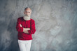 canvas print picture - Photo of attractive aged guy holding hands crossed self-confident wear red knitted pullover white trousers cool hipster santa clothes isolated grey color concrete wall background