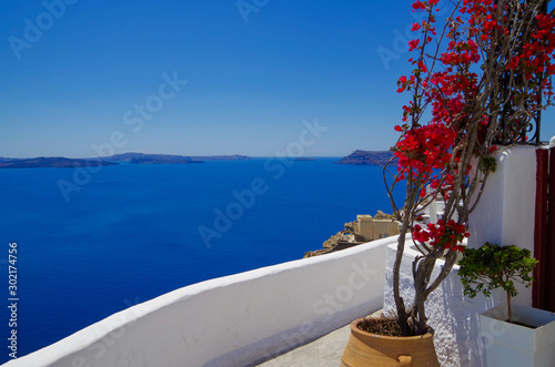 Fototapeta Amazing view over Oia town with blue domes, roofs and churches in amazing travel and honeymoon destination Santorin Santorini in the Greek Islands in the Aegean Sea during Mediterranean cruise Summer obraz