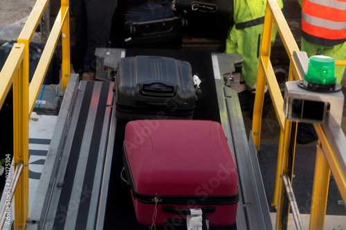 luggage loading on airplane
