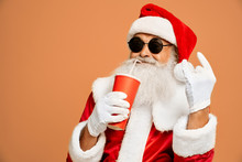 Santa Drinking From Paper Cup And Showing Two Horn Sign